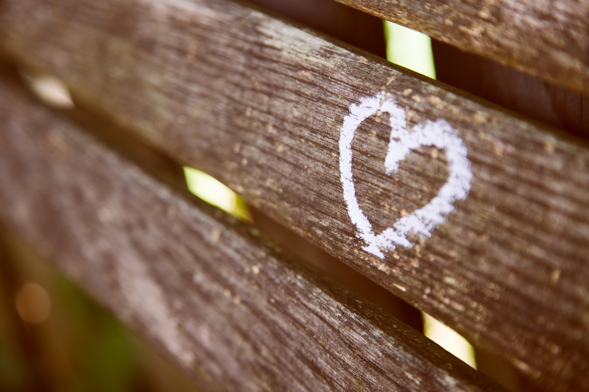 Picture of a chalk heart on wood in the woods