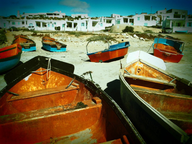 A picture of the boats on the shore at Paternoster, a fishing village in the Western Cape