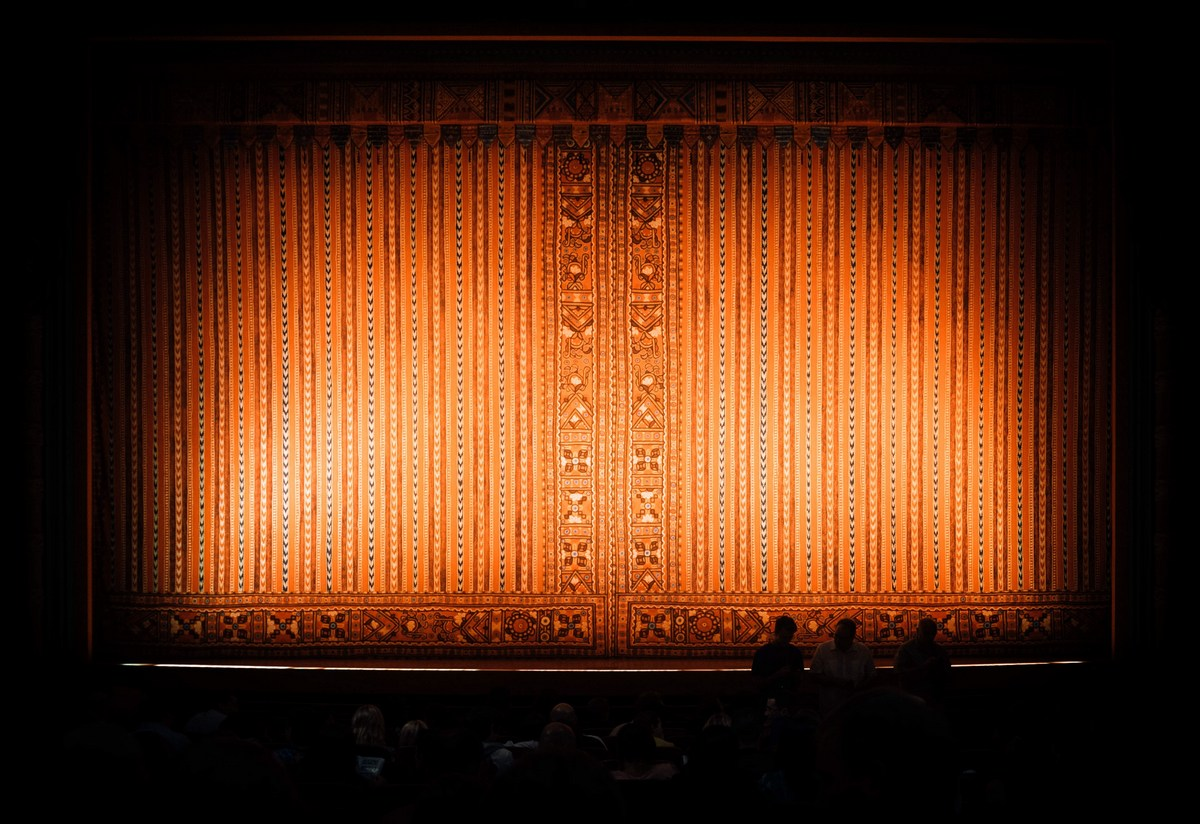 Picture of a theatre with red velvet curtains to illustrate blog post on recurring dream