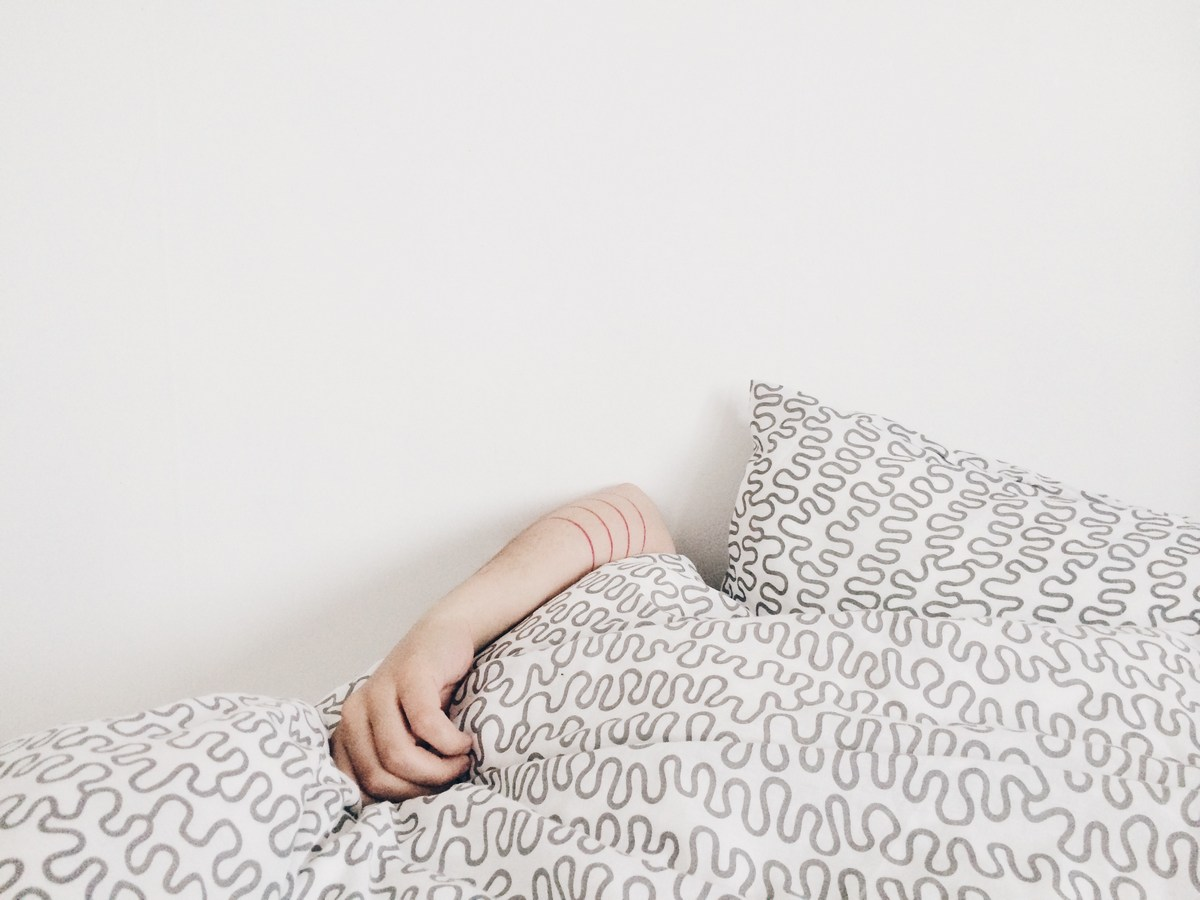 Picture of a person trying to sleep in bed