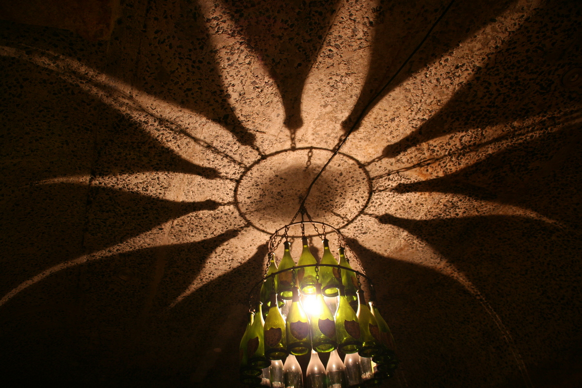A picture of the lighting fixture inside the wine cellar at Haute Cabriere wine estate in the Western Cape. Copyright Janine Papendorf